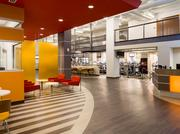 Joe Angelon says that the YMCA wanted a more modern look for the Childress Klein branch. The 6,300-square-foot lobby was one area that got new lighting and more vibrant colors as part of the makeover.