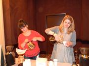 Angie MacKenzie, left, and Katie Meyers of Anodyne Coffee Roasting Co. demonstrate techniques for brewing coffee.