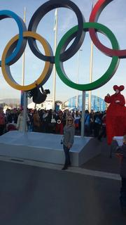 Performers at the Olympic statue.