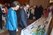 """Attendees look over the silent auction items at the """"An Evening with Master Chefs"""" event."""