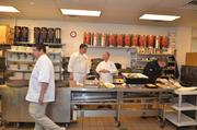 A handful of chefs in the kitchen getting ready to serve 400 hungry guests.