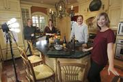 """From right, Holly Brown, her husband, Kevin Brown, chef Erin Coopey and videographer Mark Malcolm pause in between video shoots of """"The Brown Lounge"""" in the kitchen of the Browns' West Seattle."""
