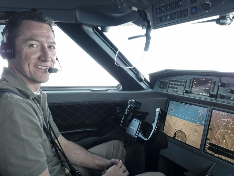 Captain Andy Eldringhoff shows off Honeywell Aerospace's Synthetic Vision 3-D maps in the cockpit of the Gulfstream G650.
