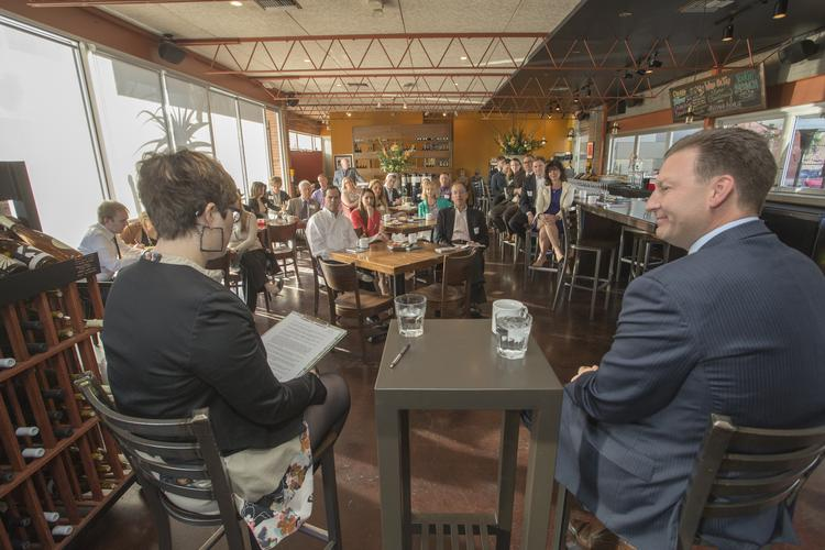 LifeLock CEO Todd Davis, right, takes questions from reporter Hayley Ringle as part of the Phoenix Business Journal's inaugural Inside the Reporter's Notebook event at Postino Winecafe in Phoenix.