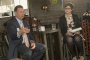 LifeLock CEO Todd Davis, left, answers a question from reporter Hayley Ringle during the first Inside the Reporter's Notebook Q&A event at Postino in Phoenix.