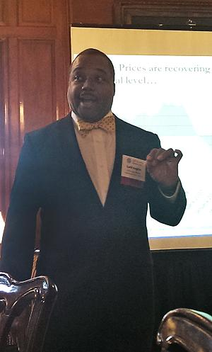 LaVaughn Henry, senior regional officer of the Cincinnati Branch of the Federal Reserve Bank of Cleveland, presents  to the Cincinnati CFA Society at the Queen City Club.