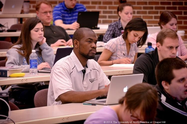 Students listen as Donald Hornstein teaches a MOOC class at the School of Law at the University of North Carolina at Chapel Hill. Students will soon have an easier time transferring from a community college to a UNC System university