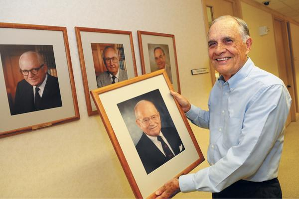 Attorney Gunner Schull holds a portrait of Russell Cades, who with his brother, Milton, was instrumental in establishing a charitable arm of their Honolulu law firm. Schull says setting up a charitable foundation is a relatively simple process for small businesses.