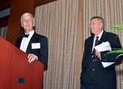 Dr. James Yankaskas, left, introduced honoree Bill Taub to the podium to say a few words.