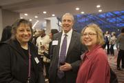 From left, Dr. Begona Campos-Naciff, Joe Cornley and Jeannette Bryson network during the Health Care Heroes event.