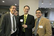 From left, Roger Howell, Steve Kenat and Chris Dobrozsi spent time networking before dinner.