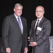 Xiaoyang Qi, right, of the University of Cincinnati College of Medicine was the winner in the Innovator category. The award was presented by Terry Horan, president and CEO of Horan, a silver sponsor of the event.