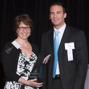 Amy McGrory of Josh Cares Child Life Program and Cincinnati Children's Hospital Medical Center was the winner in the Provider category. Chris Bennington, partner at Bricker & Eckler and member of the Cincinnati-Dayton office Health Care Group, presented the award.