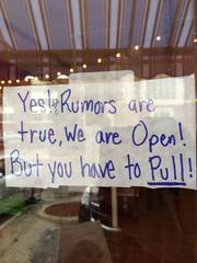 A small, hand-written sign is how Corner Taco let passersby know it was open for business.