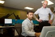 Amit Kumar, (left) a senior systems analyst, and Aaron Reich, director of innovation at Avanade, work on a radio frequency identification project for the Seattle-based company.