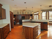 12212 Hadley Hill Road: The kitchen features cherry cabinets and a walk-in pantry.
