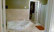 12614 Bradford Woods Drive: The main bath features a Whirlpool tub.