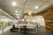 "Douron president Ronald Hux wanted a ""wow factor"" for visitors entering the company's offices, so he hired Arris Design to build the sculpture wall made of deconstructed wooden pallets."