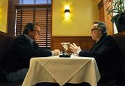 Bill Husted talks with Jon Williams at Elway's in Cherry Creek. Williams got a taste of the cultured life when his father ran the cotillion program at The Broadmoor hotel in Colorado Springs.