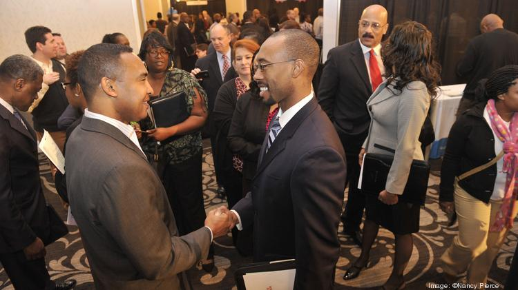 Then-mayor Patrick Cannon (left) greeted job-seekers at a job fair earlier this year. Last week, he resigned after the FBI arrested him on public corruption charges.
