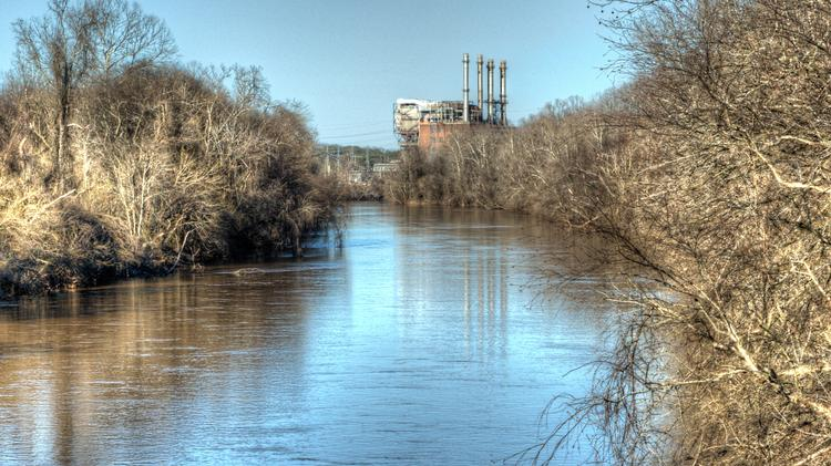 Duke Energy's shuttered power plant in Eden, where up to 39,000 tons of coal ash sludge leaked into the Dan River in early February. Now federal officials say small amounts of coal ash continue to leak from a third pipe on the site.