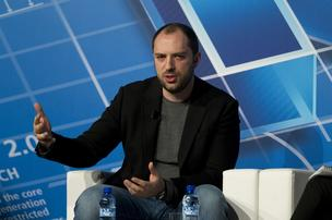 Jan Koum, chief executive officer of WhatsApp Inc., speaks during a keynote address on the opening day of the Mobile World Congress in Barcelona, Spain.