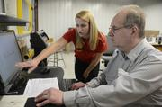 Natalie Krieg works on a project for the laser with John Sikorski of Mason.