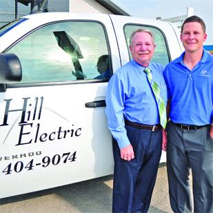 (L-R) Billy Hill and his son, Billy Ross Hill, are using the tools necessary to get the job done. But, pleasing the customer is still their priority.