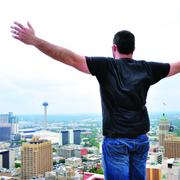 Zac Harris, operations director, Geekdom stands on top of the Weston Centre downtown.