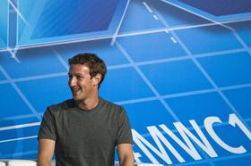 Mark Zuckerberg, chief executive officer of Facebook Inc., reacts during a keynote session on the opening day of the Mobile World Congress in Barcelona, Spain, on Monday, Feb. 24, 2014.