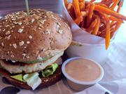 'The Skinny' turkey burger with apple cider sauce and sweet potato fries.