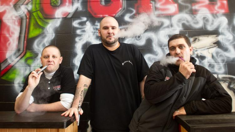 Andrew Schimd, left, Joshua McBride, center, and Allyn Yarger are the owners of Buckeye Vapors, which has grown to be a $1-million business.