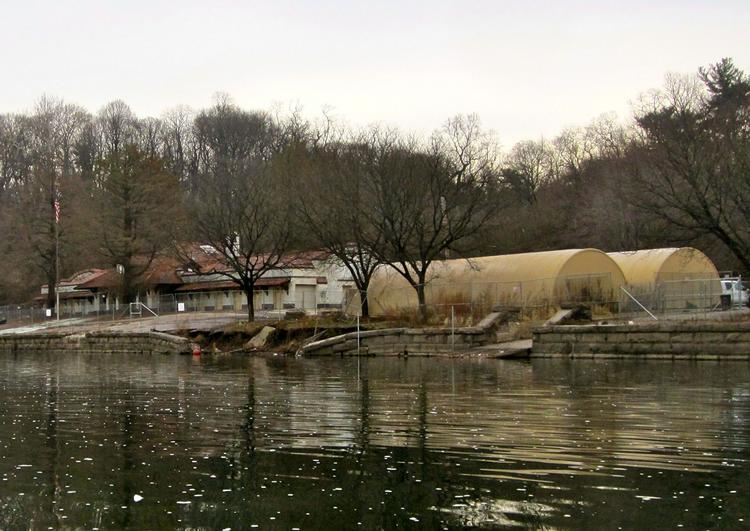Temple University's rowing teams were based in the East Park Canoe House (at left) until 2008,when the city condemned the facility. Since then, the teams have rowed out of the two tents (at right). On Monday, the city announced plans to renovate the Canoe House for Temple's use.