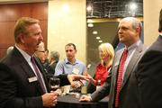 Paul McBroom with BB&T talks with Mike Chapman of Holland & Knight