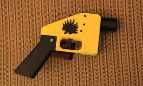 Bill Dominico, of CopBlock, introduced Cody Wilson at the event and brought along his own Liberator, complete with the Libertarian porcupine logo.
