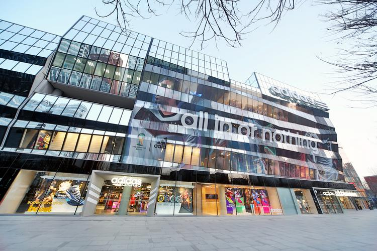 The outside of the new Adidas retail store in Beijing is designed to look like the facade of an athletic arena. Click through the gallery to see more of the new of the new store.