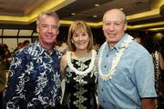 Dee Jay Mailer, center, CEO of Kamehameha Schools, with husband Donnie Mailer, left, and Neil Hannahs, director of land assets division for Kamehameha Schools, at the Mahiai Match-Up Agricultural Business Plan Contest fundraising gala at Dole Cannery's Pomaikai Ballrooms.