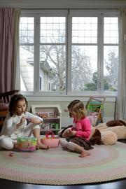 Lucy and her sister Clementine Canlis play in their bedroom.