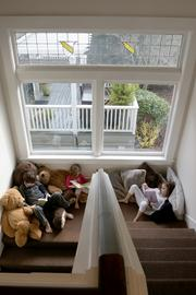 William, Clementine and Lucy enjoy reading on the teddy-bear-filled island between the main floor and upstairs.