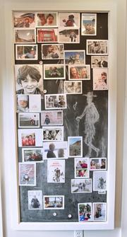 A magnetic blackboard in the kitchen is one of the many family photo montages in the Canlis home.