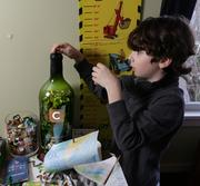 William keeps a bottle cap collection is an old wine bottle from his family's restaurant Canlis.