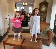 """Clementine and Lucy sing along to the song """"Let It Go"""" from the movie """"Frozen"""" in the den of their home."""