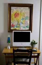 """The painting by William Canlis, 8, """"Sunshine Over the Village"""" is part of his 2010 (preschool) series and displayed in the dining room."""