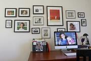 Like much of their home, Anne Marie Canlis' home office features many family photos.