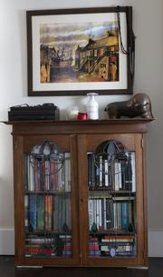 The cabinet below this Michael McVeigh painting is from Mark Canlis' parents home.