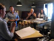 Block Butcher Bar chef Michael Tuohy gives his staff instructions before opening Monday afternoon.