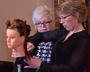 Paul Mitchell student Janice Clavet with learning leader Terry Sandgren.