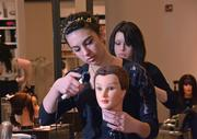 Paul Mitchell students, from left Autumn Martini and Katie Miller.