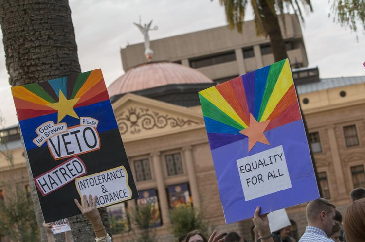 A crowd on Feb. 24 gathers at the Arizona Capitol to urge Gov. Jan Brewer to veto SB 1062, which critics say will allow discrimination. Backers of the bill say it protects religious freedom. The debate on social media has turned nasty in recent days.