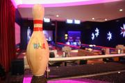 This bowling pin welcomes guests to a private room for parties and meetings.
